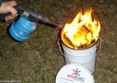 Ignition a STOPGEL antifreeze candle with a small torch